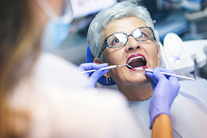 Senior female patient at dentist office for root canal