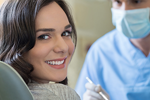 Smiling woman at dentist for a root canal