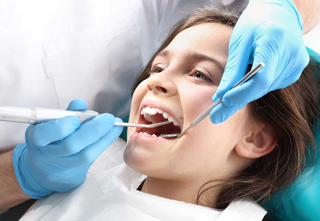 A Dentist Examing The Teeth of a Patient